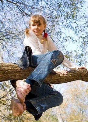 4770101-teen-girl-climbing-on-the-tree-in-an-autumn-park